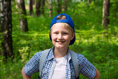 Young boy hiking in forest Stock Image