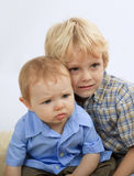 Young boy with his baby brother. A portrait of a young boy with his baby brother Stock Images