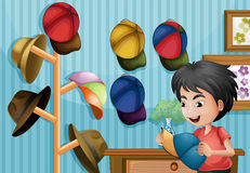 A young boy and his cap collection. Illustration of a young boy and his cap collection Royalty Free Stock Photography