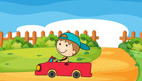 A young boy in his car Royalty Free Stock Image