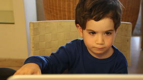Young boy by his computer stock video