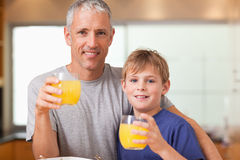 Young boy and his father having breakfast Royalty Free Stock Photo