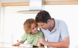 Young boy and his father using a tablet computer Stock Image
