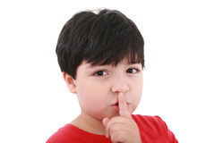 Young boy with his finger over his mouth Royalty Free Stock Photo