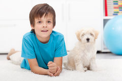 Young boy and his good behaving doggy. Together indoors Royalty Free Stock Images