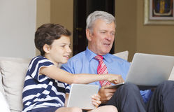 Young boy and his grandfather Stock Photos