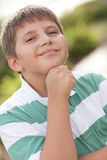 Young boy with his hand under chin Royalty Free Stock Image