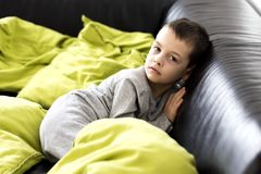 There`s a boy in the living room. Royalty Free Stock Photo