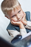 Young boy on his laptop computer. At home Royalty Free Stock Photo