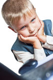 Young boy on his laptop computer. A boy on his laptop computer at home on a white background Royalty Free Stock Images