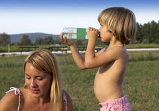 Young boy with his mother outdoors Royalty Free Stock Photo