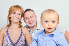 Young boy with his parents in the background stock image