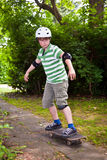 Young boy on his skate board Stock Photo