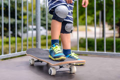 Young boy with his skateboard on a ramp Royalty Free Stock Image