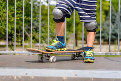 Young boy with his skateboard on a ramp Stock Photo