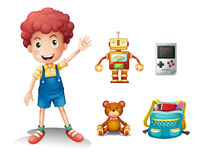 A young boy and his toys Stock Photography