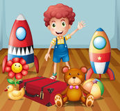 A young boy with his toys inside the room Stock Photo