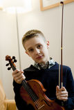 Young boy with his violin Stock Photos