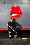 Young Boy in Hockey Dressing Room Stock Images