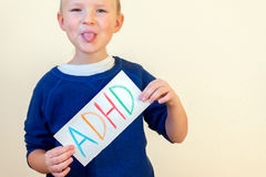 Young boy hold ADHD text Stock Images