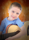 Young Boy Holding Acoustic Guitar Royalty Free Stock Photo