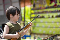 Young boy holding an air gun Royalty Free Stock Images
