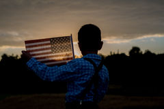 Young boy holding an American Flag, grateful for Freedom Stock Images
