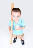 Young boy holding a baseball bat and ball. On white background Stock Photography