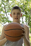 Young boy holding basketball in his hand Stock Photos