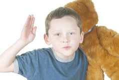 Young boy holding bear. Young boy acting tough holding bear Royalty Free Stock Photo