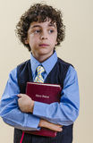 Young Boy Holding a Bible Stock Image