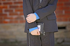 Young boy holding a bible hands close up Stock Photography