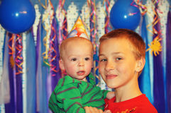 Young Boy Holding a Birthday Boy Royalty Free Stock Photos