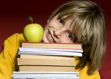 Young boy holding books Stock Images