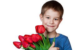 Young boy holding bouquet of tulips Stock Photo