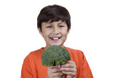 Young boy holding broccoli Royalty Free Stock Image