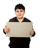 Young boy holding cardboard Stock Photo