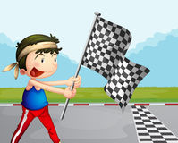 A young boy holding a checkered banner Royalty Free Stock Photos