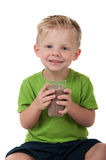 Young boy holding chocolate milk on white Stock Photography