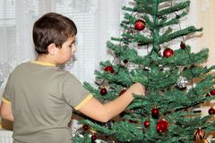 Young boy holding Christmas decorations Stock Image