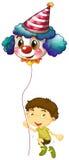 A young boy holding a clown balloon Stock Photo