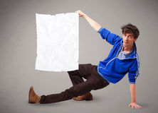 Young boy holding crumpled white paper copy space Royalty Free Stock Images