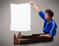 Young boy holding crumpled white paper copy space Royalty Free Stock Photography