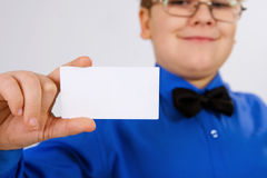Young  boy holding an empty advertising card Royalty Free Stock Image
