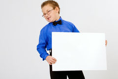 Young  boy holding an empty advertising card Royalty Free Stock Photography