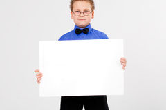 Young  boy holding an empty advertising card Stock Photography