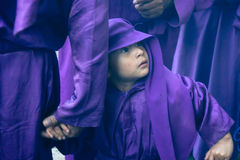 Young boy holding fathers hand during Lent Sunday Procession Stock Images