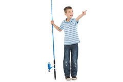 Young boy holding fishing rod pointing Royalty Free Stock Photo