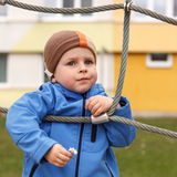 Young boy holding flower on the playground Stock Photography