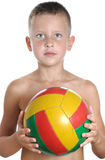 Young boy holding football Stock Image